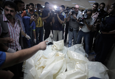 Journalists and photographers at Shifa Hospital. (Photo: AP) (Photo: AP)