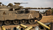 A tank and used ammunition in Kfar Aza Photo: Gettyimages