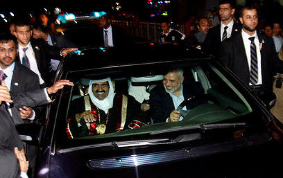 Former Qatari emir Al Thani and Ismail Haniyeh in Gaza in 2012 (Photo: AP)