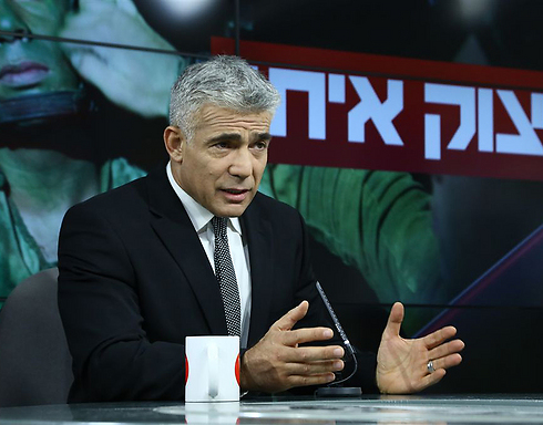 Finance Minister Yair Lapid speaking at the Ynet studio (Photo: Ofer Amram)