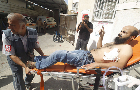 Wounded Palestinian evacuated to hospital (Photo: AFP) Photo: AFP