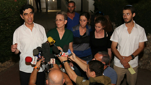 Hadar Goldin's family speaking to reporters (Photo: Ido Erez)