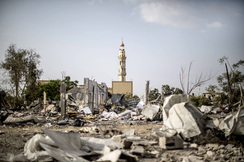 A mosque still standing amid the ruins of a neighborhood in Gaza. Photo: AFP