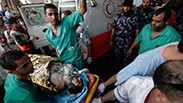 A wounded man brought to the emergency room at Shifa Hospital. Photo: AP