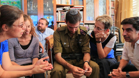 Deputy Eitan visiting the Goldin family. (Photo: Vicky Photographers) Photo: Vicky Photographers