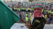 A boy holds a Muslim Brotherhood flag during a rally in support of Palestinians in Gaza, in Amman Photo: Reuters