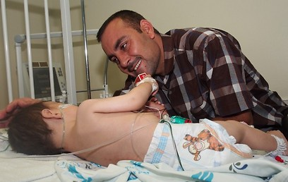 Wisam and his father in hospital in Israel (Photo: Courtesy of Save a Child's Heart)