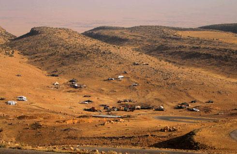 פליטים יזידים שנמלטו מחרבם של הג'יהאדיסטים (צילום: רויטרס)