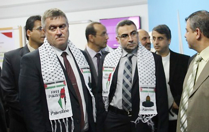 British Consul General Alastair McPhail, left, wearing the scarf (Photo: Islamic Relief Palestine)  (Photo: Islamic Relief Palestine)