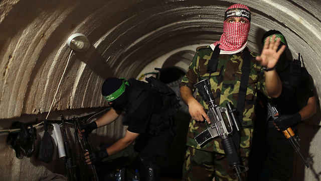 Al-Qassam Brigades giving Reuters tour of terror tunnel (Photo: Reuters)