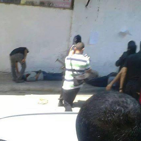 Moments after the executions in Gaza.