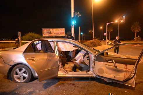 The Maman brothers' car after it was hit by shrapnel from the Grad rocket (Photo: Avi Rokach)