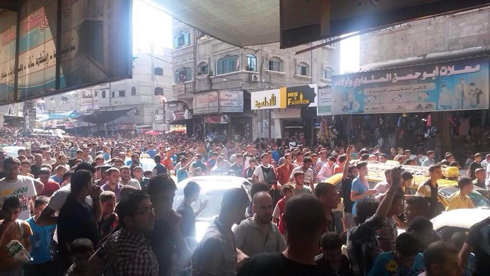 Crowds gather to watch the execution in Jabaliya.