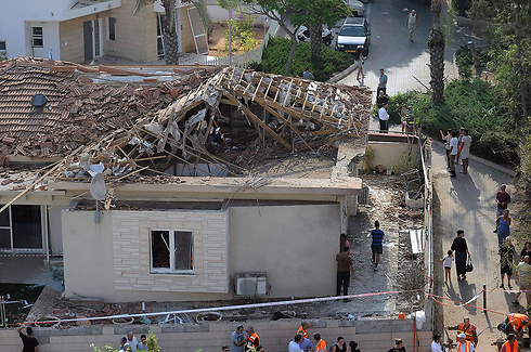 A home in Ashkelon damaged by rocket fire. (Photo: AFP) (Photo: AFP)