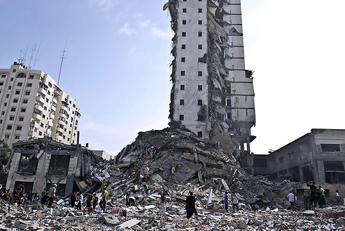 Destroyed high-rise building in Gaza (Photo: AFP)