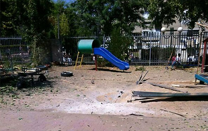 The damage caused to the kindergarten playground.
