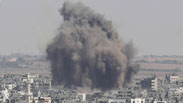 Smoke rises in Gaza City after an Israeli airstrike during Operation Protective Edge Photo: Reuters