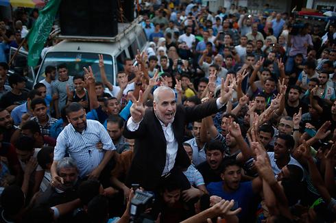 Hamas spokesman Fawzi Barhoum celebrates a Hamas 'victory' in Gaza (Photo: Reuters) (Photo: Reuters)
