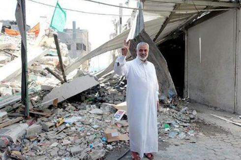 Hamas leader Haniyeh amid the ruins of his home.