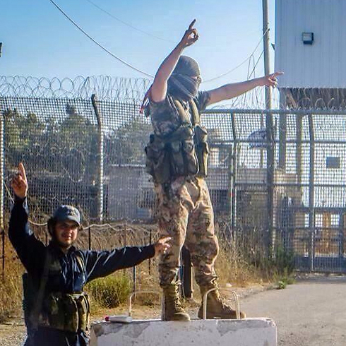 Nusra Front fighters celebrate victory near the Israeli border on the Syrian Golan.