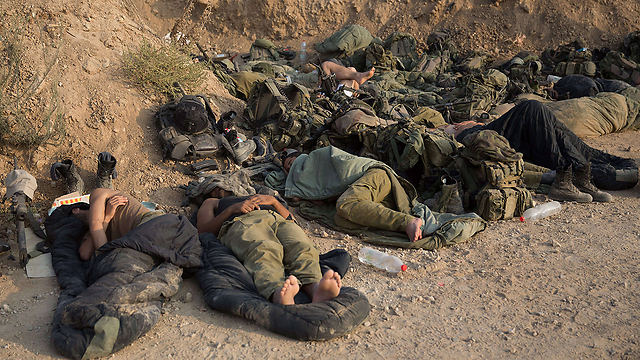 IDF troops resting on the Gaza border during Protective Edge (Photo: AFP) (Photo: AFP)