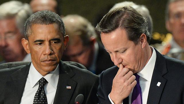 """קמרון ואובמה בפסגת נאט""""ו (צילום: EPA)"""