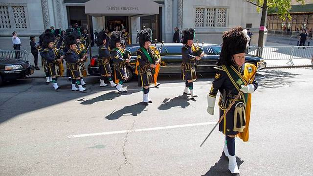 Bagpipes play a farewell to Rivers (Photo: AP)