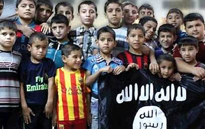 Children in Iraqi orphanage holding ISIS flag