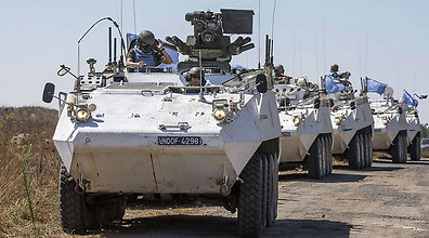 Filipino peacekeepers crossing border from Syria to Israel (Photo: AFP)