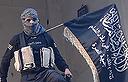 לוחם של ג'בהת א נוסרה (צילום: AFP)