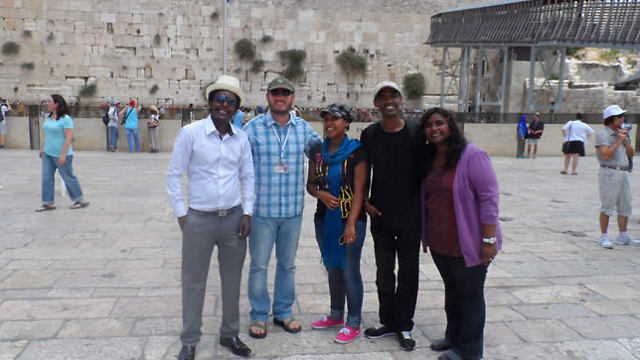The Ethiopian doctoral students - Workey Tigabie, Naomi Teshome, and Hailemaryam Alemu - visit the Western Wall.
