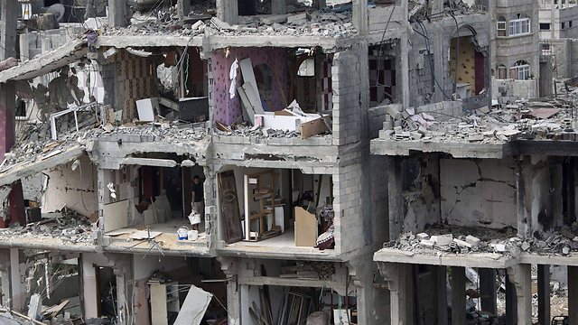 Destroyed building in the Strip (Photo: AFP)