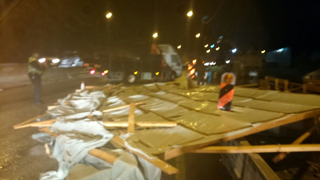 Makeshift roof blown across Route 1 (Photo: Police)