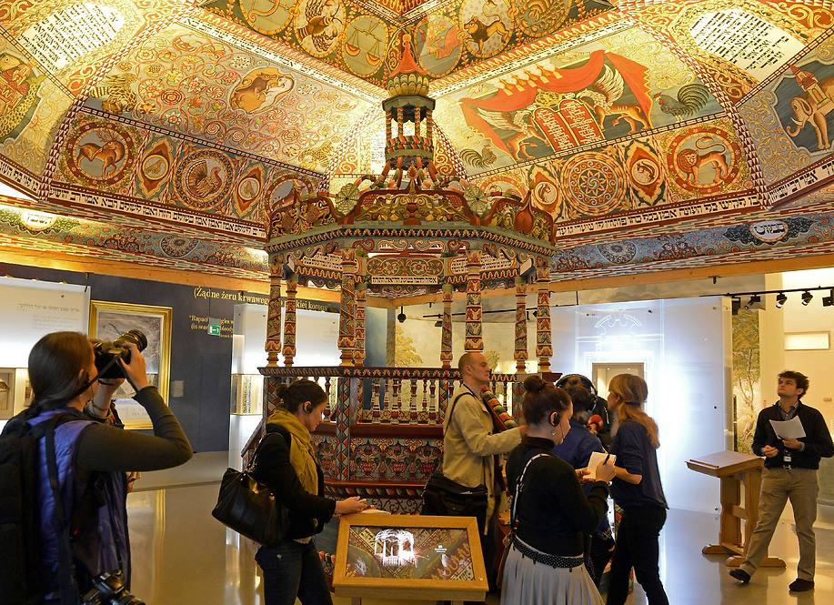 The reconstructed ceiling of the wooden synagogue from Gwozdziec village and Bimah, a platform in the synagogue, as part of the 'Jewish Town' gallery (Photo: AFP)