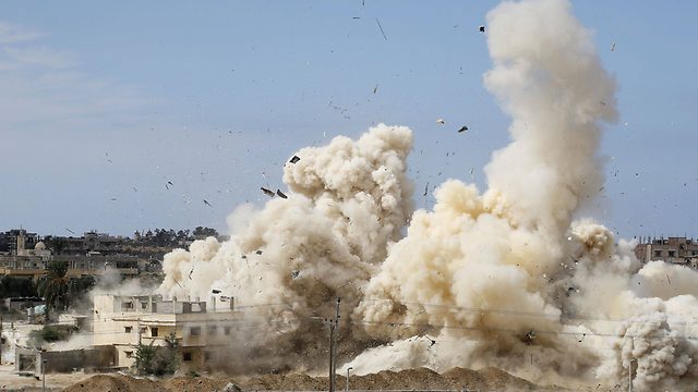 Huge explosions blast buildings in Rafah. (Photo: AFP)