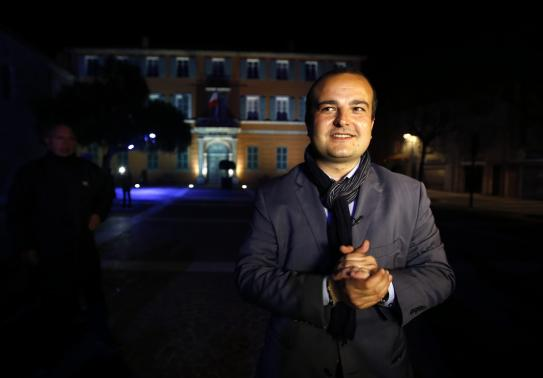 Mayoral candidate David Rachline of France's far-right National Front political party poses in front of the town hall (Photo: Reuters)