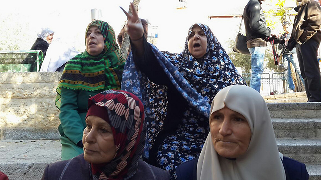 Dozens of women gathered to demonstrate. (Photo: Mohammed Shinawi)