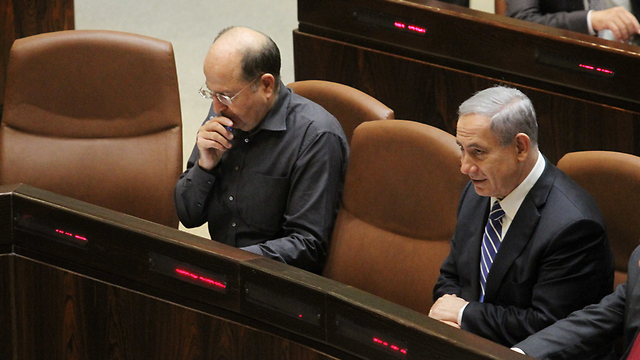 Moshe Ya'alon (left) ordered Muslim charities be shut for alleged ties to 'terror'. (Photo: Ido Erez)