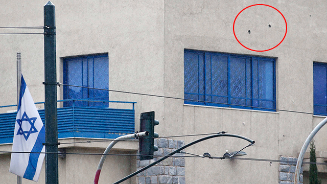 Bullet-holes in Israeli embassy in Athens (Photo: Reuters)