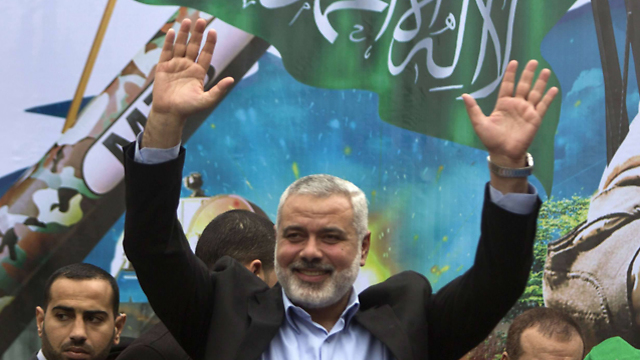 Hamas leader Ismail Haniyeh waves to the crowd. (Photo: AFP) (Photo: AFP)