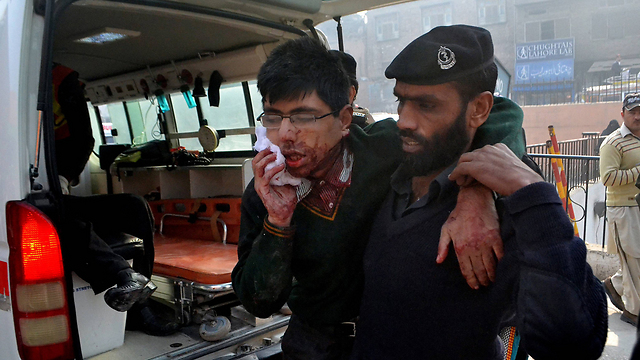 Wounded student is rescued (Photo: AP)