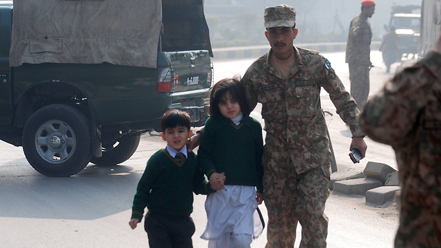 Children are evacuated (Photo: Reuters)