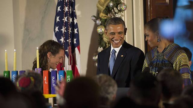 Barack and Michelle Obama at the White House Hanukkah party (Photo: AFP)