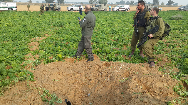 IDF soldiers locate site where rocket fell in Eshkol Regional Council. (Photo: Roee Idan)