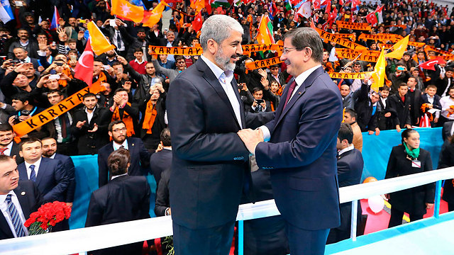 Mashal with Prime Minister Ahmet Davutoglu (Photo: Reuters)