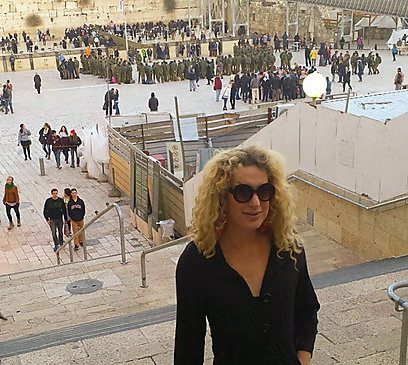 Kay Long takes a photo with the Western Wall in the background. (Photo: Facebook)