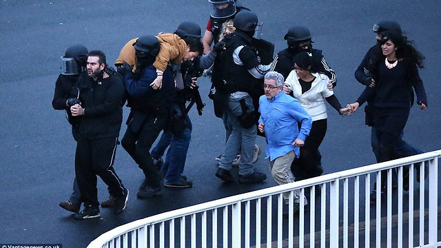 Hostages flee kosher supermarket attack in Paris with help of police.