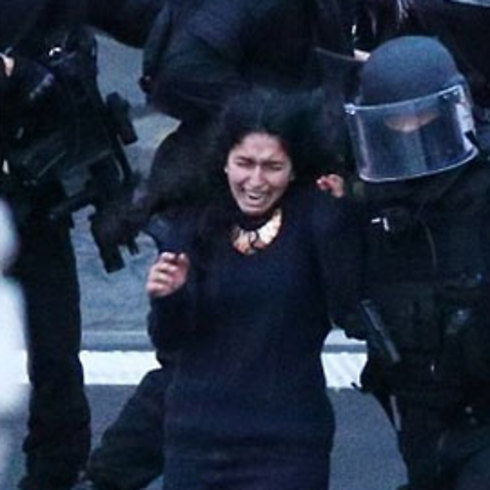 A police officer escorts one of the hostages from the Hyper Cacher attack.