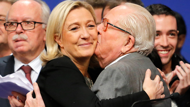 Marine Le Pen with her father Jean-Marie. He is committing 'political suicide,' she says. (Photo: AP)