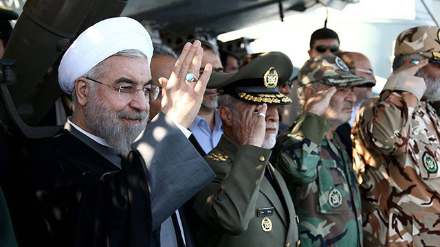 Iranian President Hassan Rouhani solutes soldiers. (Photo: EPA)